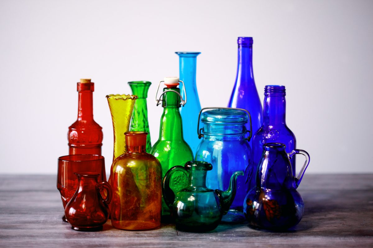 Colorful bottles lined up in a rainbow pattern.
